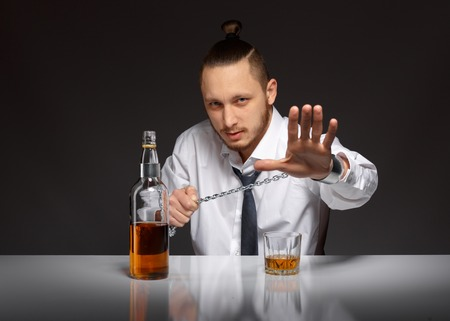 social emotional: Emotional young businessman screaming STOP habit to alcohol. Addicted to alcohol, alcoholism concept, social problem Stock Photo