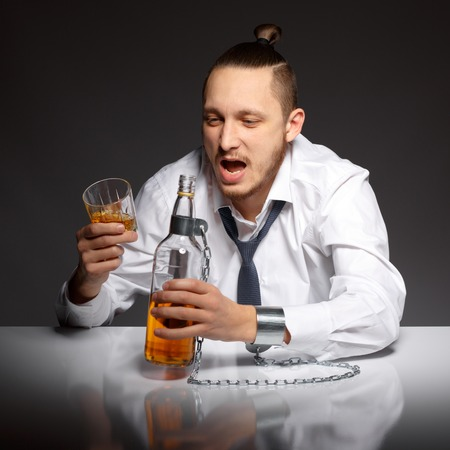 dipsomania: Young man thirsty to drink an alcoholic beverage. Addicted to alcohol, alcoholism concept, social problem