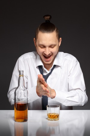inebriated: Young man thirsty to drink an alcoholic beverage.