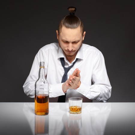 alcoholic beverage: Young man thirsty to drink an alcoholic beverage.