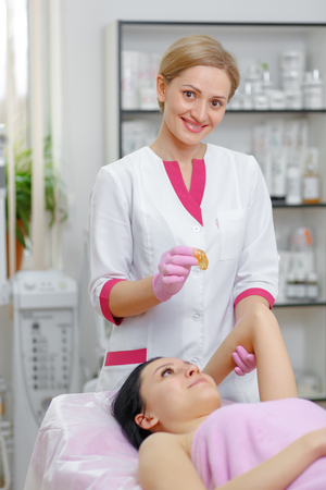 cosmetologist: Portrait, Master Cosmetologist by sugar hair removal in beauty salon
