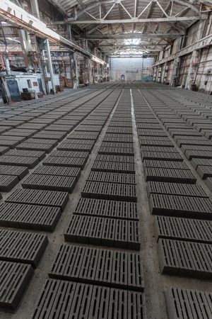 aerated: Stack of bricks. Manufacturing of aerated concrete blocks. Manufacturing of cinder block. The plant manufactures building material. The plant produces a cinder block. Cinder block-building material.