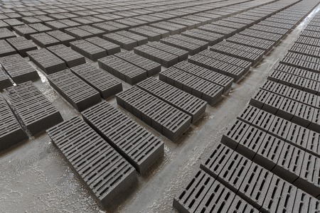 cinder: Stack of bricks. Manufacturing of aerated concrete blocks. Manufacturing of cinder block. The plant manufactures building material. The plant produces a cinder block. Cinder block-building material.
