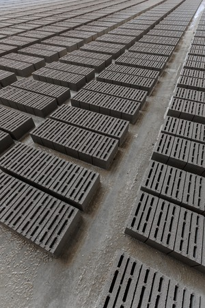 consignment: Stack of bricks. Manufacturing of aerated concrete blocks. Manufacturing of cinder block. The plant manufactures building material. The plant produces a cinder block. Cinder block-building material.