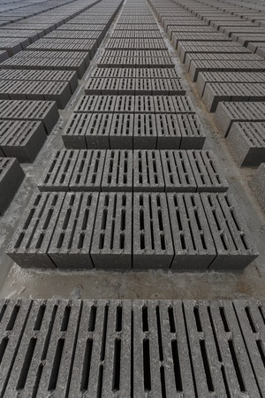 residual: Stack of bricks. Manufacturing of aerated concrete blocks. Manufacturing of cinder block. The plant manufactures building material. The plant produces a cinder block. Cinder block-building material.