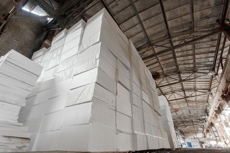 expanded: Polystyrene insulation boards. Polystyrene plates warehouse. Polystyrene Stack Stock Photo
