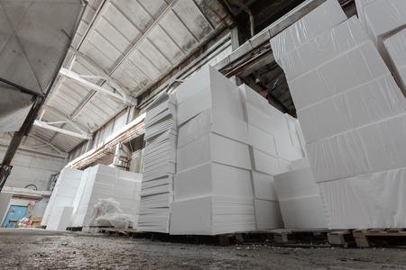 polystyrene: Polystyrene insulation boards. Polystyrene plates warehouse. Polystyrene Stack Stock Photo