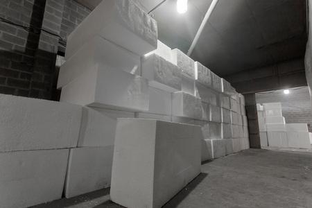polystyrene: Large blocks of polystyrene. Polystyrene insulation boards. Polystyrene plates warehouse. Polystyrene Stack