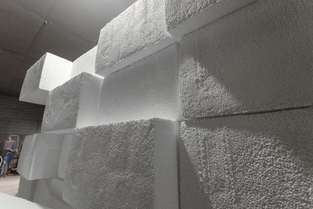 Large blocks of polystyrene. Polystyrene insulation boards. Polystyrene plates warehouse. Polystyrene Stack