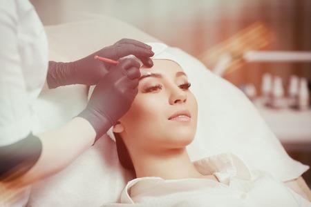 Permanent makeup eyebrows. Stock Photo