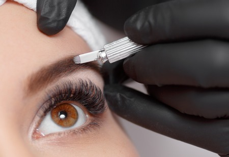 protective gloves: Permanent makeup eyebrows. Stock Photo