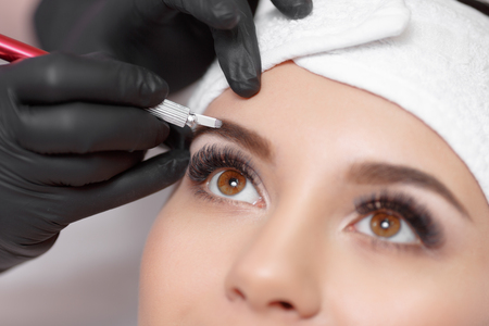 Permanent makeup eyebrows. Stock Photo