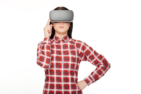 Woman in headset spending time in virtual reality.