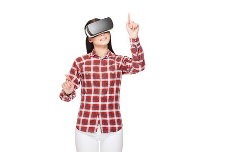 Girl in VR headset making choose and pointing by fingers.