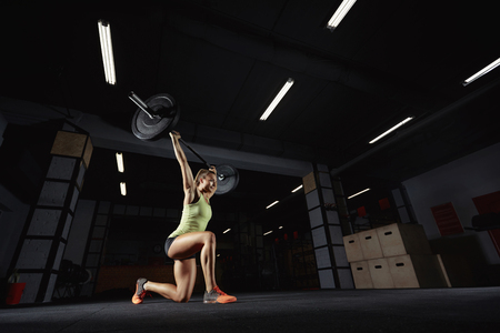 Female crossfit athlete exercising