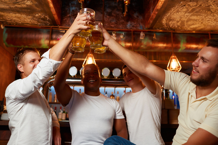 Nice evening of memories of male friends in interesting pub. Stock Photo