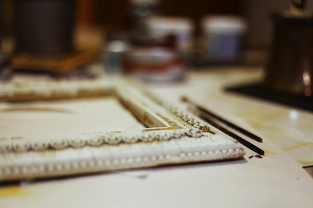 DIY Frame with Paint and Brushes