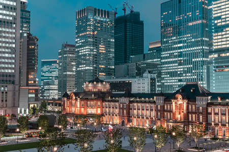 Night view of Tokyo cityscape in front of Tokyo Railway Station, the biggest and busiest railway station in Japan.