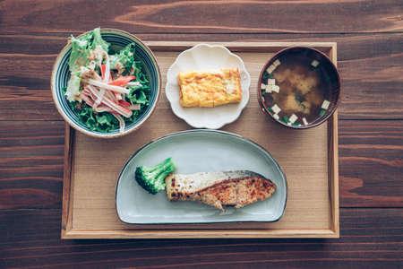 "Japanese set lunch, fried salmon fish with miso soup (""tonjiru"") ."