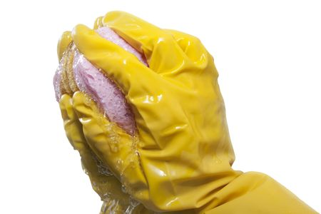 humidify: hand in yellow glove cleans a  mirror