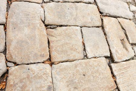 adoquines: un pavimento de adoquines de piedra