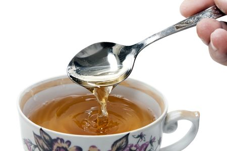 teaparty: teacup and spoon isolated on a white background