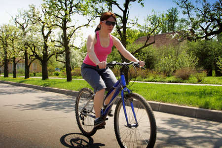 bycicle: young lady driving bycicle