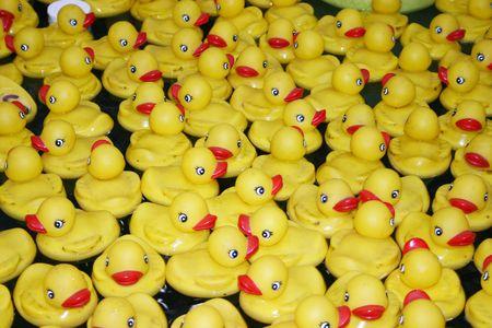Rubber ducks sitting ontop of water floating Zdjęcie Seryjne