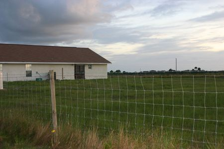 House on a field in the evening