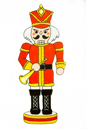 A nutcracker soldier dressed in a red uniform holds a brass bugle  Stock Photo