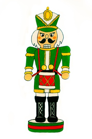 A nutcracker soldier dressed in a green uniform beats a red drum