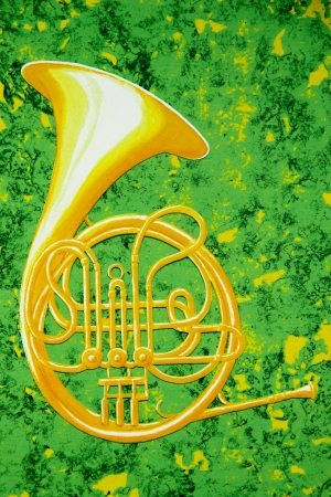 french horn: A brass French horn  is against an abstract background of green and gold