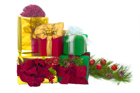 A gold foil-wrapped gift topped by a red damask bow, a green-wrapped gift topped by a red damask bow, a red damask gift topped by gold paper ribbons and bow, a gold-foil-wrapped gift with a red curly bow and a green-wrapped gift with a white bow are stack