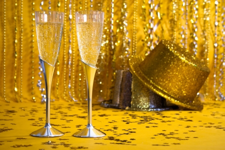 fluted: Two flutes of bubbling champagne are against a sparkly background. Stock Photo