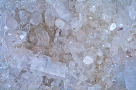 crystal background: White and amber quartz crystal shapes form abstract patterns