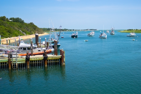 Boats are moored in a bay near the Chatham Fish Pier, MA, on Cape Cod