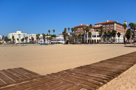 Hotels are connected to the sandy beach with boardwalks at Santa Monica Beach, California