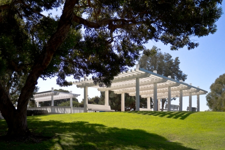 Shady wooden structures provide  resting places at Chace Park in Marina Del Rey, California  Imagens