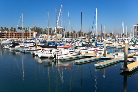 Sailboats and masts are reflected in the water at Marina Del Rey, California