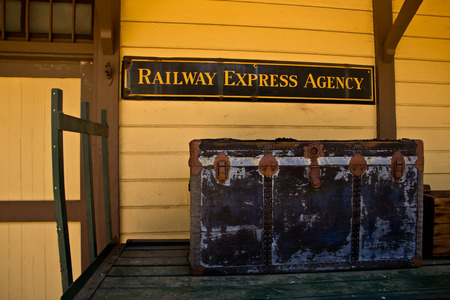 An antique railway express trunk sits on an old cart in Saugus, California.