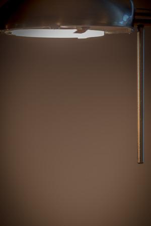 bronze background: reading light illuminating copy space with bronze background.