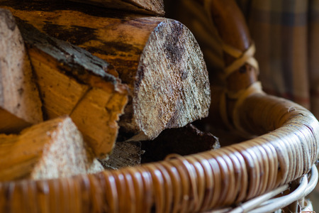 home comforts: detail of log basket showing close up of logs.