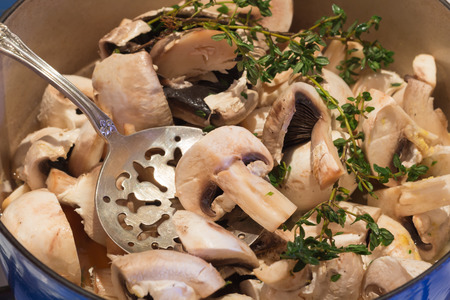 slotted: mushroom soup with slotted spoon, cooking on the hob Stock Photo
