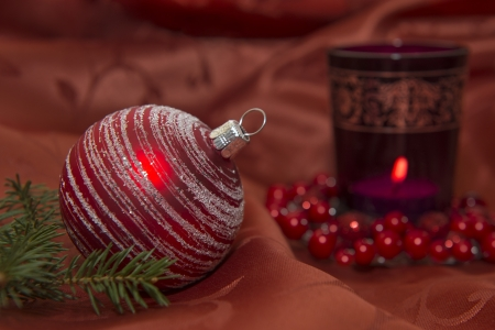 Red Christmas Glitter Ball With Candle Stock Photo