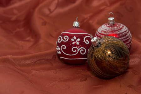 Trhe Christmas Glitter Balls On Red Floral Underground