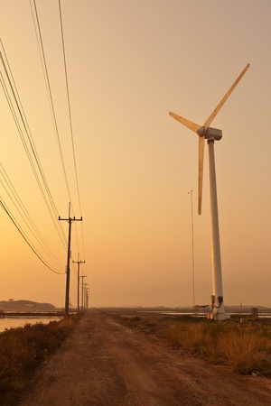 turbine beside dust road photo