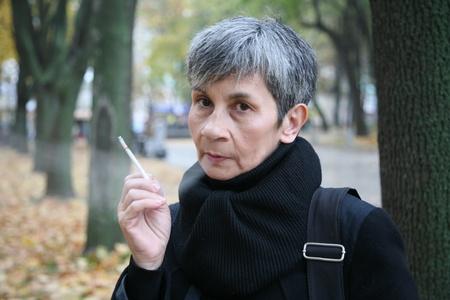 Portrait of senior woman smoking a cigarette