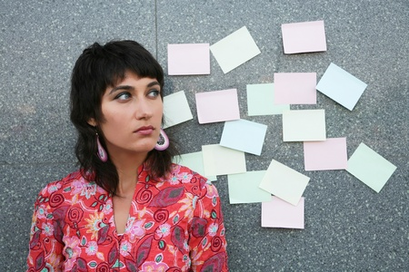 embarassed: Young woman considering an option  version  Stock Photo