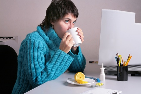Woman in the office feels she is getting ill photo