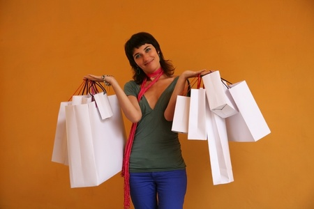 Young woman with a lot of shopping bags photo